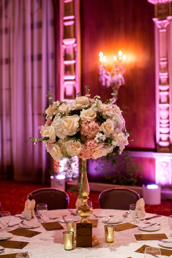Elegant tall wedding centerpiece with roses and hydrangea