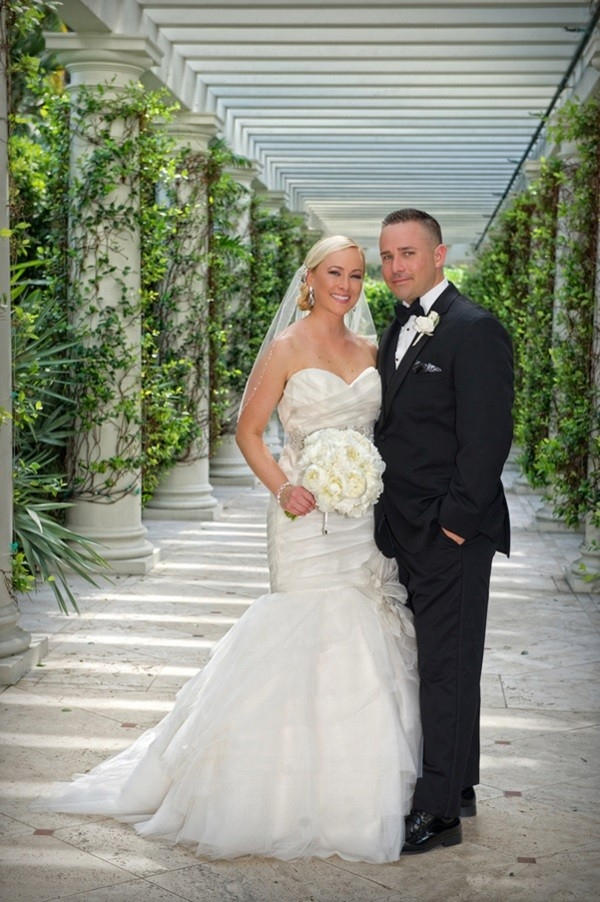 Classic bride and groom portrait surrounded by greenery