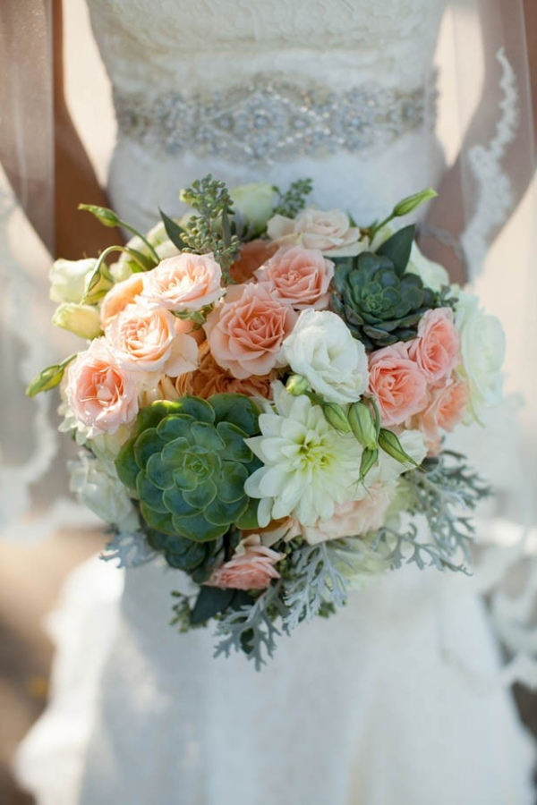 Romantic peach rose and succulent bridal bouquet