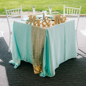 Turquoise and gold sweetheart table
