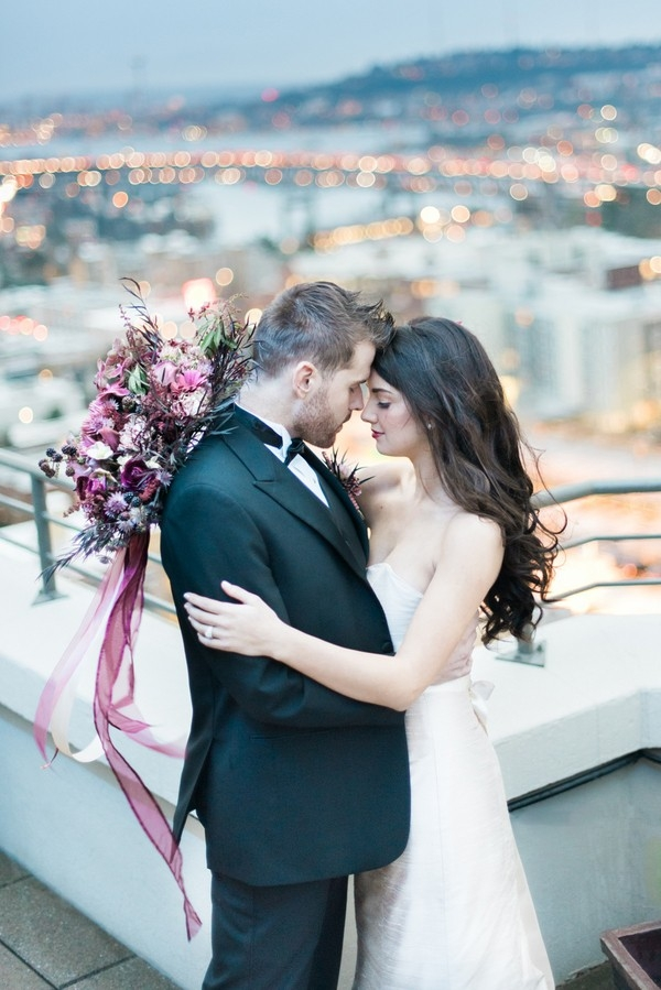 Romantic bride and groom on rooftop
