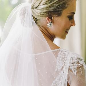 Classic destination wedding bridal look with a simple veil, BHLDN earrings and a Rosa Clara gown