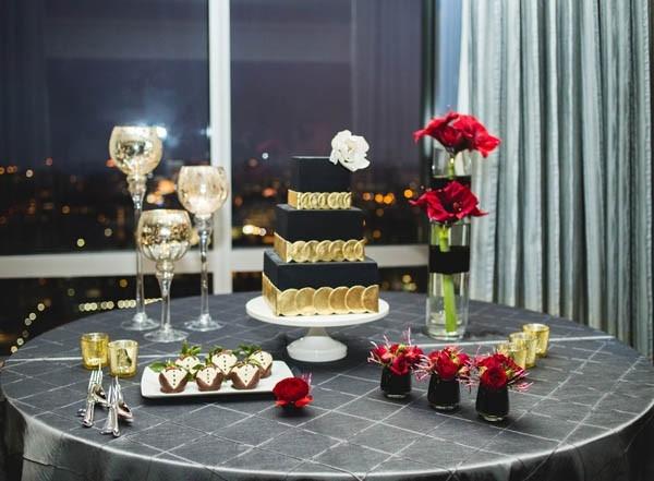 Elegant black, gold and crimson dessert display