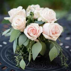 Elegant pink rose and seeded eucalyptus cocktail hour centerpiece