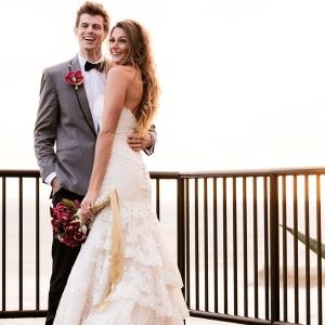 Bride and groom posing overlooking the ocean at The Inn at Laguna Beach