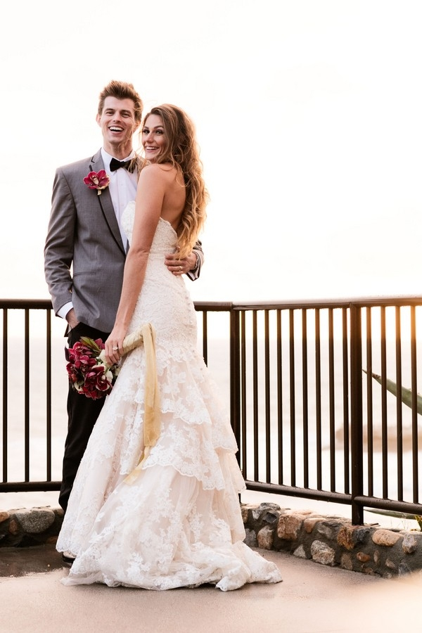 Bride and groom posing overlooking the ocean at The Inn at Laguna Beach