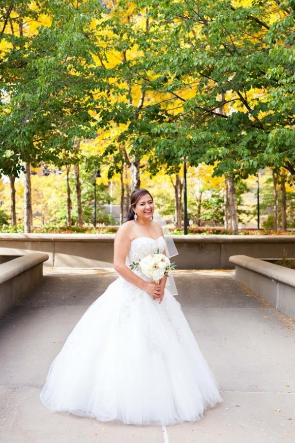 Elegant bride wearing a ball gown wedding dress with sweetheart neckline