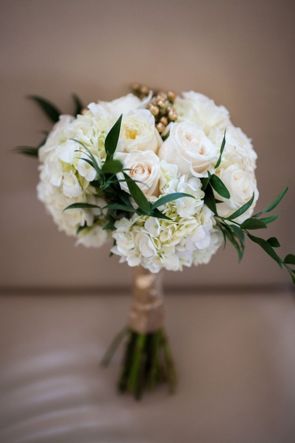 Elegant white wedding bouquet with gold highlights and greenery