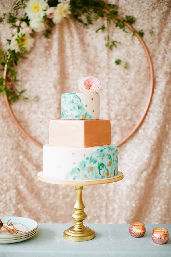 We adore this modern wedding cake with turquoise painted layers and metallic rose gold details