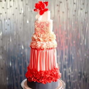 Modern coral wedding cake with different textures