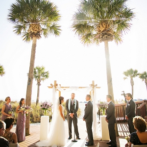 Outdoor ceremony under palm trees