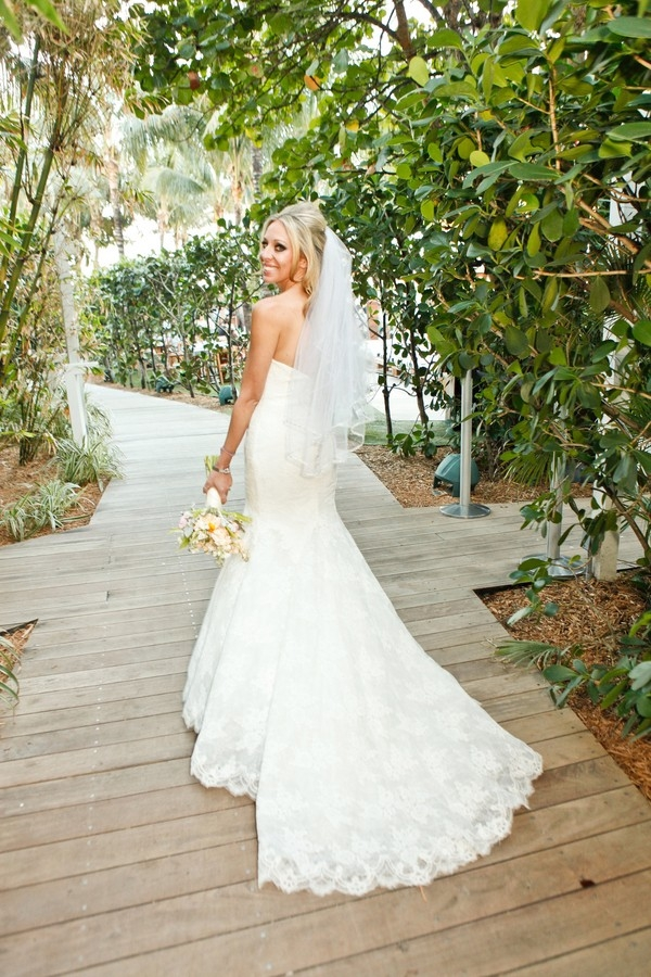 Beach bride in fit and flare wedding dress with sweetheart neckline