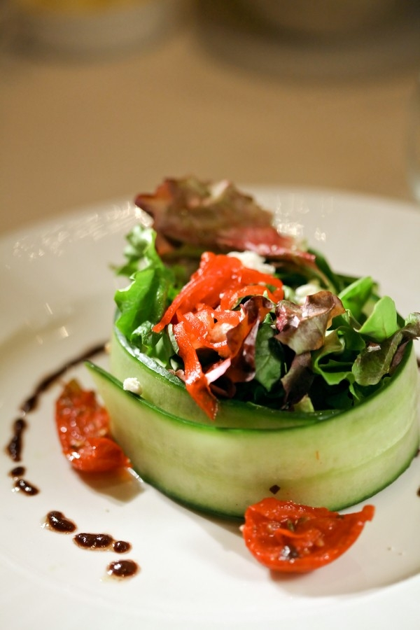 Elegant salad wrapped in a cucumber slice