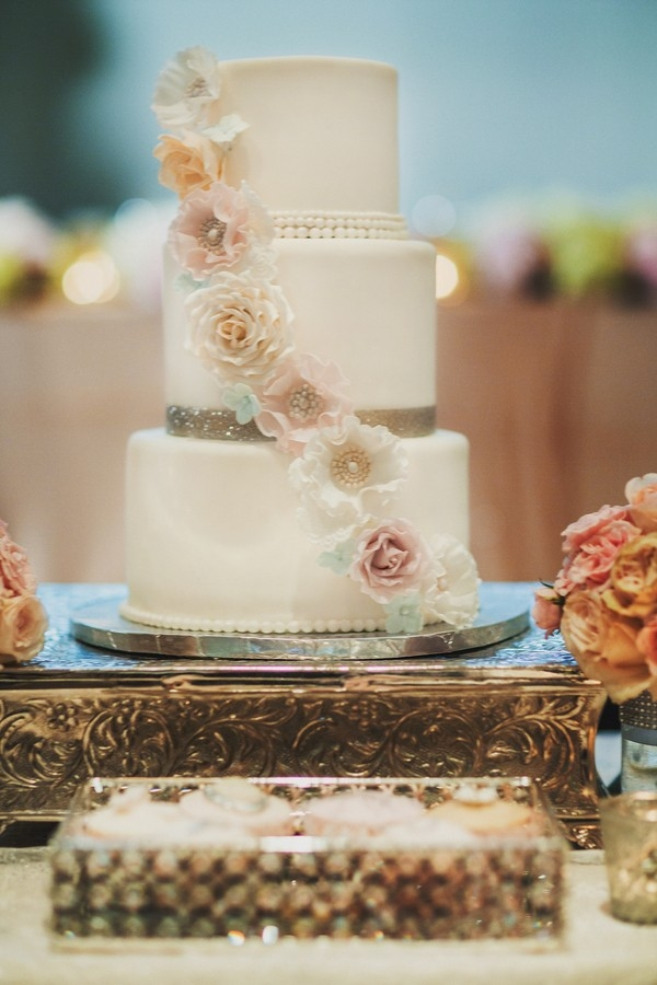 Fairy tale inspired wedding cake with sparkly bands and pastel sugar flowers