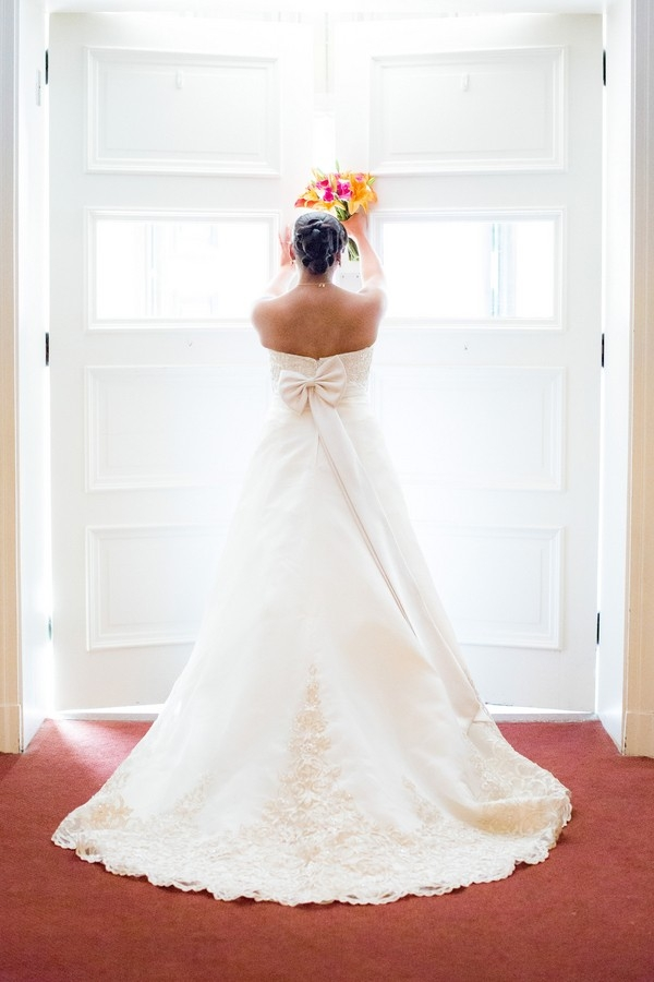 Traditional Alfred Angelo wedding dress with sash tied in a bow