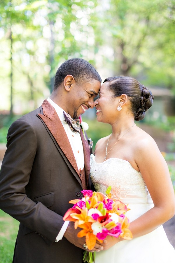 Adorable bride and groom posing nose-to-nose