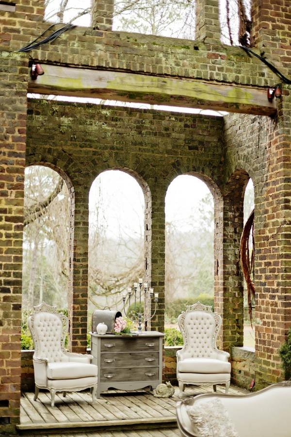 Vintage lounge furniture set up at the historic Barnsley Resort's antebellum manor ruins