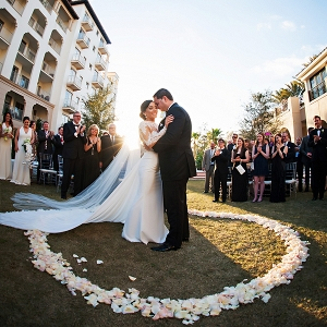 Unique ceremony setup in a circle with the couple in the center surrounded by a ring of flower petals