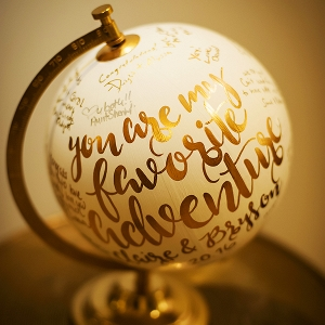 """You are my favorite adventure"" gold and white globe used as a wedding guest book alternative"