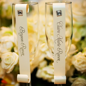 Chic champagne flutes with scroll style place cards