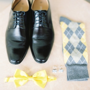 Gray and yellow groom's accessories neatly organized