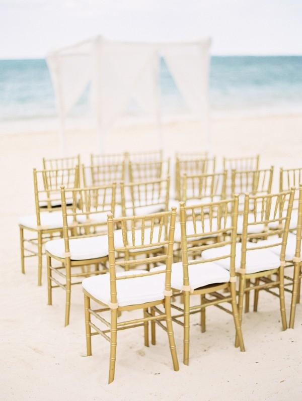 Gold chiavari chairs for beach wedding in Jamaica