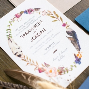 Bohemian wedding invitation with feather motif