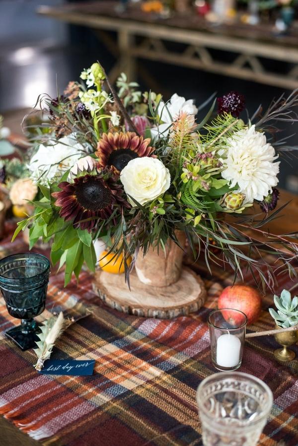 Rustic fall wedding centerpiece with tartan runner
