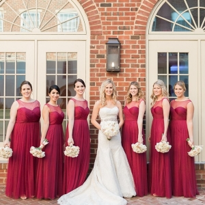 Bridesmaids in matching crimson Jenny Yoo dresses