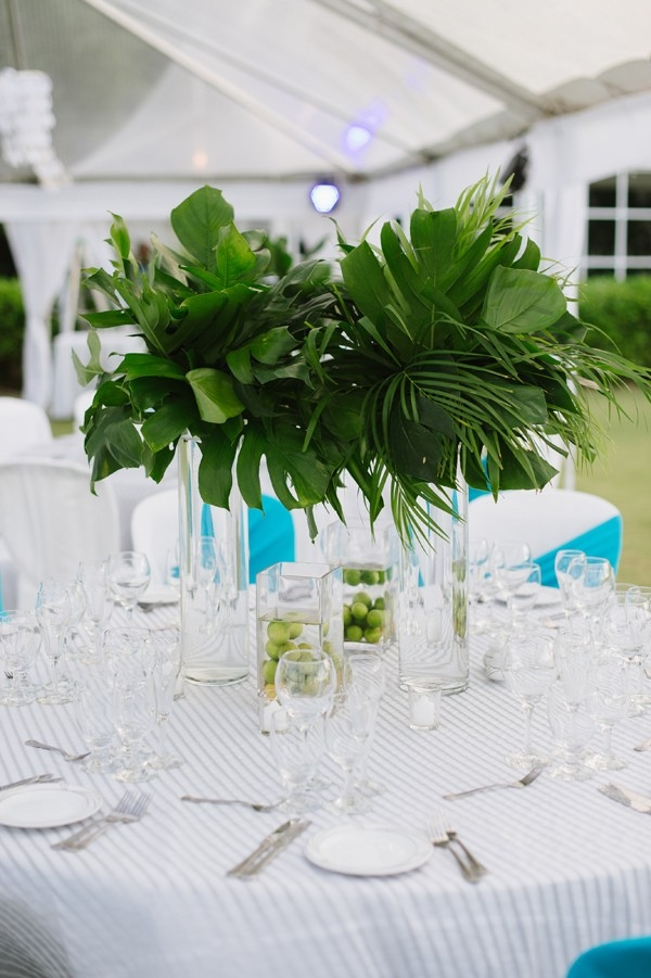 Tropical tablescape with striped tablecloth