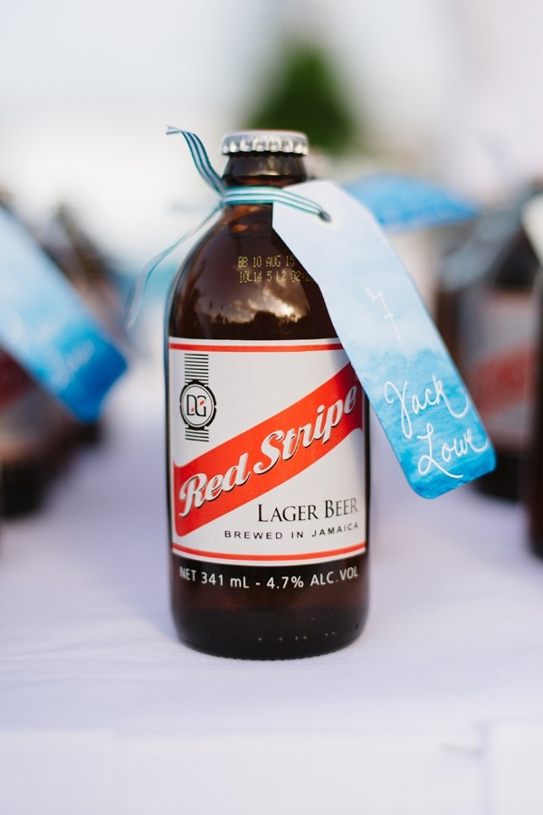 DIY Red Stripe beer escort cards with watercolor luggage tags