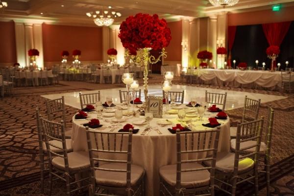 St. Regis Monarch Beach ballroom set up for red rose themed wedding
