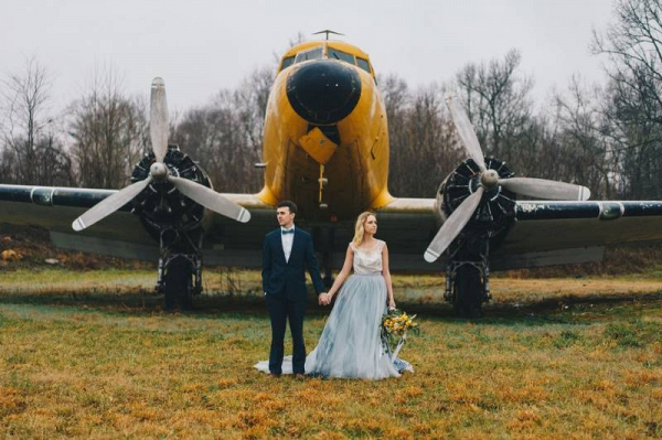 Vintage airplane engagement session with blue tulle dress