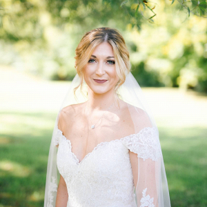 Bride in off the shoulder lace wedding dress