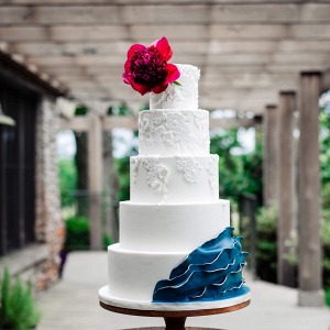 Red and blue wedding cake with lace detailing