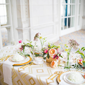 Modern vintage wedding table with printed linens