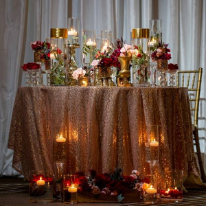Modern romantic sweetheart table with sequin linens