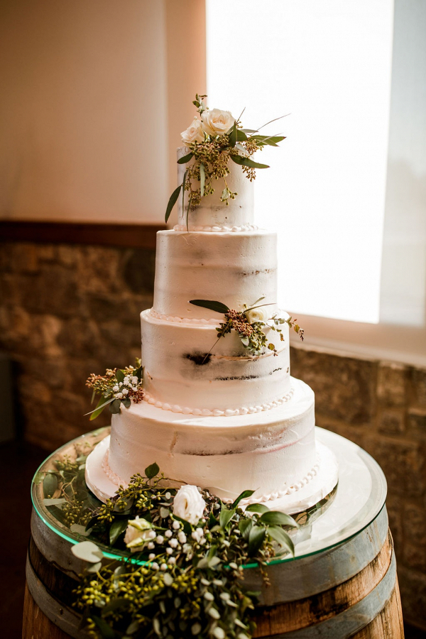 Classic semi naked cake with greenery