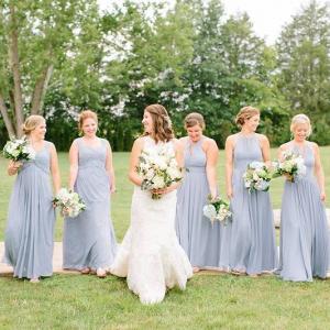 Bridesmaids in light blue dresses