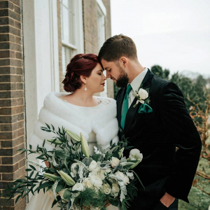 Vintage bride in fur wrap with groom