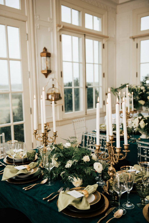 Elegant emerald green and gold wedding reception