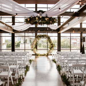 Greenery wedding ceremony with floral circle arch