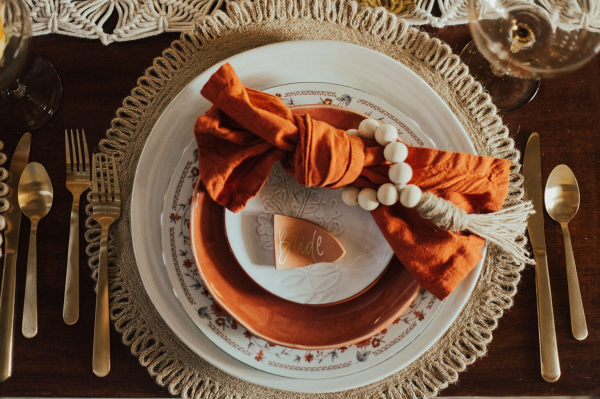 Boho wedding table design with terracotta place card