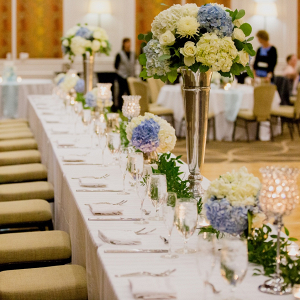 Classic wedding party table with hydrangea florals