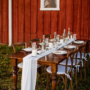 Barn wedding table with bottle centerpieces