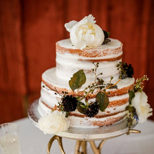 Classic semi naked wedding cake with fresh florals