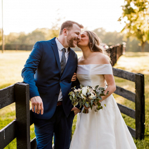 Classic groom with bride in off the shoulder gown