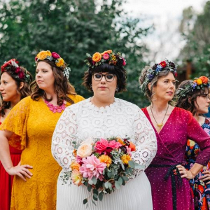 1771e5eb51 Teal wedding cake with red flowers  Colorful mismatched bridesmaid dresses  ...