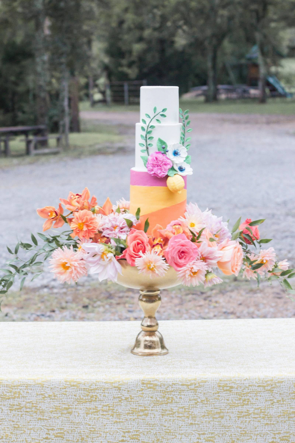 Colorful wedding cake with florals