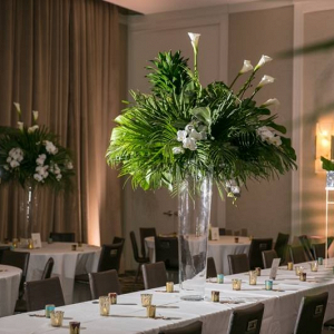 Tall palm leaf wedding centerpieces